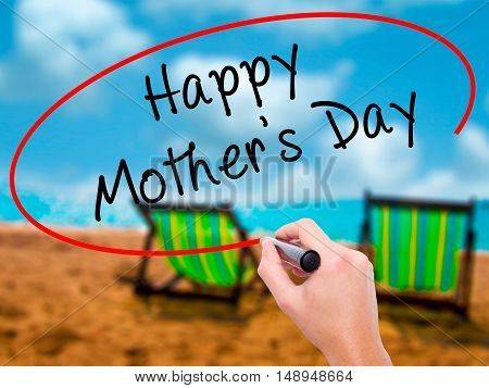 Man Hand Writing Happy Mother's Day With Black Marker On Visual Screen