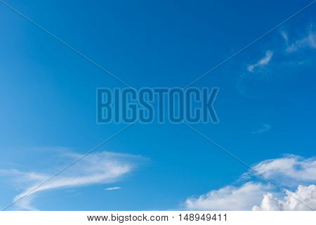 image of clear blue sky and white clouds on day time for background usage.