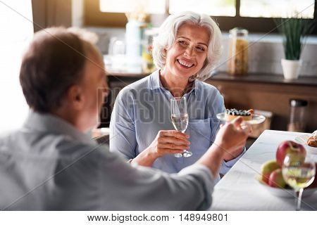 Forever young. Portrait of old classy grey-haired lady holding glass of white wine