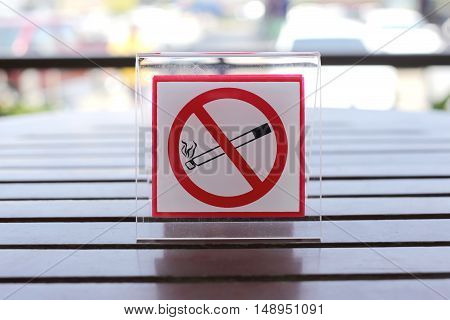 Signs of no smoking on the table in restaurant.
