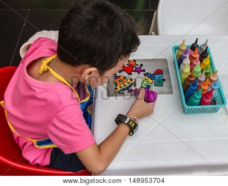 Children's activities, children's. coloring for children brightly coloured paint pots for activity