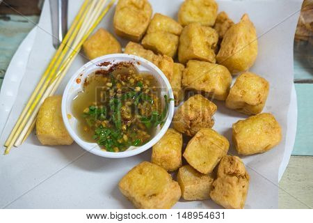 Snack and dessert deep fried tofu or fried Bean curd served with sweet and sour spicy sauce.
