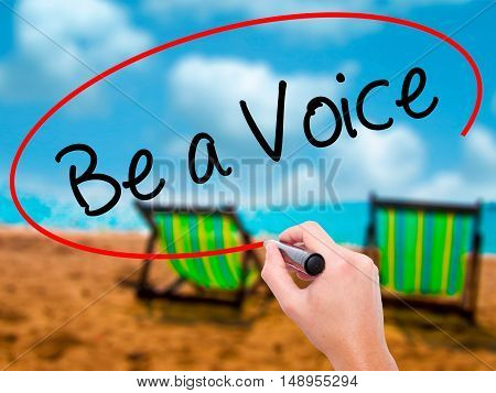 Man Hand Writing Be A Voice With Black Marker On Visual Screen