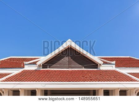 The Red rooftop against blue sky on outdoors