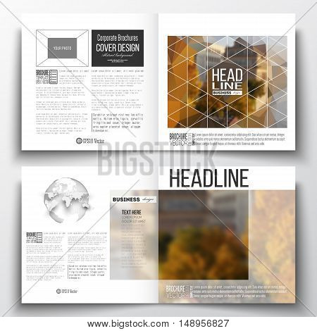 Set of annual report business templates for brochure, magazine, flyer or booklet. Polygonal background, blurred image, urban landscape, cityscape, modern stylish triangular vector texture.