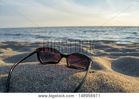 Shades laying down on the beautiful sandy beach