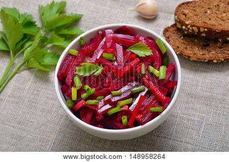 Salad with beet and green onion top view