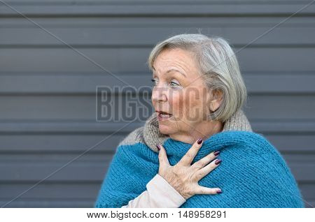 Startled Elderly Woman Clasping Her Chest