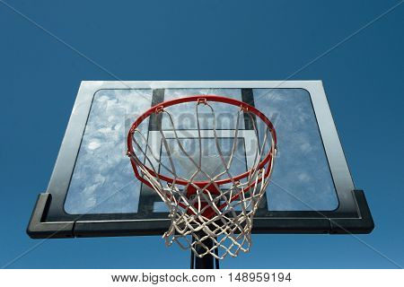 Basketball hoop outdoors on a background of blue sky