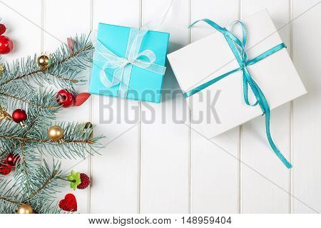 Christmas gift boxes with decorations on the wooden background.