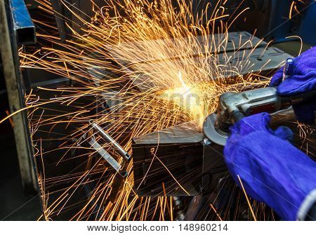 Sparks motion while grinding iron in factory