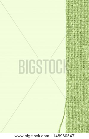 Textile tissue fabric patch green canvas crisscross material closeup background