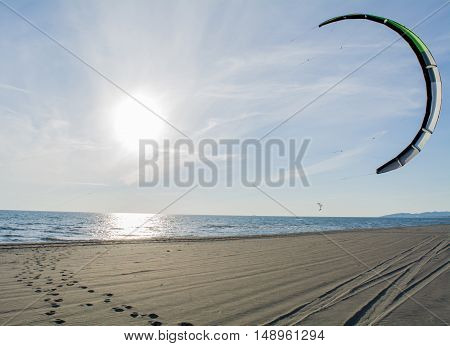 Kite surfers on the beautiful sandy beach