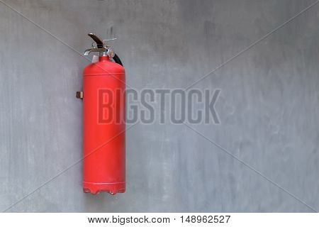 Old fire Extinguisher on the concrete wall