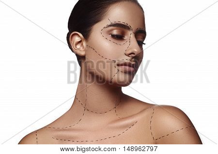 Beauty brunette Woman with dashed Line on Body and Face Pieces. Surgery Advertising