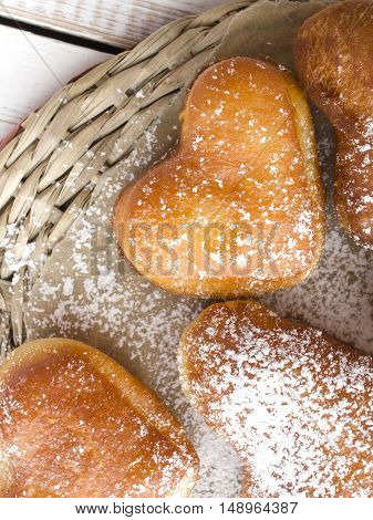closeup of a heart shaped donuts - tasty snack