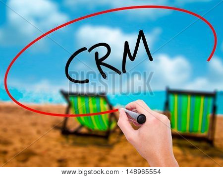 Man Hand Writing Crm With Black Marker On Visual Screen