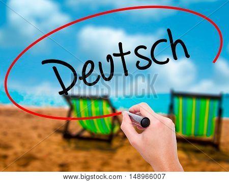 Man Hand Writing Deutsh (german In German) With Black Marker On Visual Screen