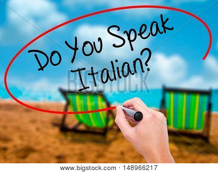 Man Hand Writing Do You Speak Italian? With Black Marker On Visual Screen