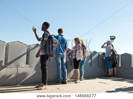 Lviv, Ukraine - July 22, 2016: People enjoying the view on city from the observation deck