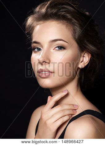 Close Up Woman Face With Beautiful Eyes And Perfect Skin On Black Background
