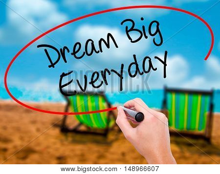 Man Hand Writing Dream Big Everyday With Black Marker On Visual Screen