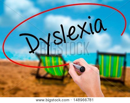 Man Hand Writing Dyslexia With Black Marker On Visual Screen