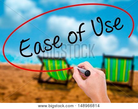 Man Hand Writing Ease Of Use With Black Marker On Visual Screen