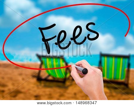 Man Hand Writing Fees With Black Marker On Visual Screen