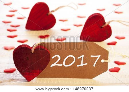 Label With Text 2017 For Happy New Year. Many Red Heart. Wooden Rustic Or Vintage Background.