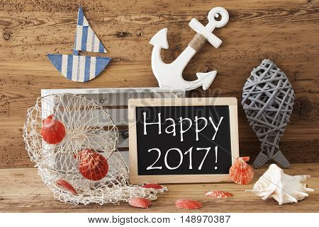 Blackboard With Nautical Summer Decoration And Wooden Background. English Text Happy 2017. Fish, Anchor, Shells And Fishnet For Maritime Contex.
