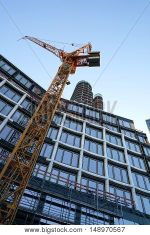 BERLIN, GERMANY - MAY 13, 2016: Construction crane at the construction site of the Upper West. The Upper West is a new hotel and office building on the Kurfürstendamm in Berlin
