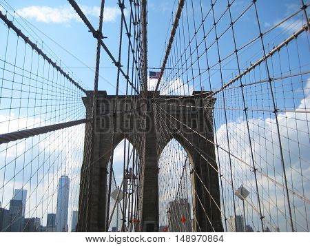Brooklyn Bridge in New York City, USA one of the most oldest brides in America connects Brooklyn and Manhattan over East river with downtown Manhattan skyscrapers landscape background close up