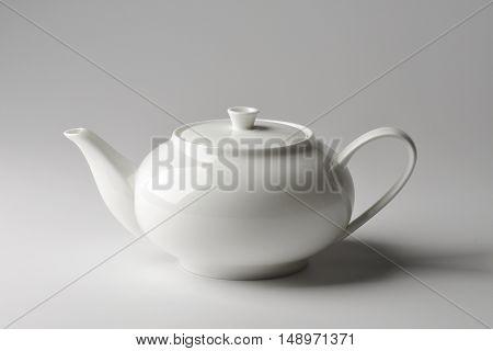 Isolated Spherical teapot white porcelain on white