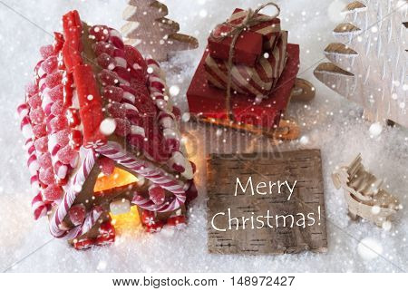 Label With English Text Merry Christmas. Gingerbread House On Snow With Christmas Decoration Like Trees And Moose. Sleigh With Christmas Gifts Or Presents And Snowflakes.