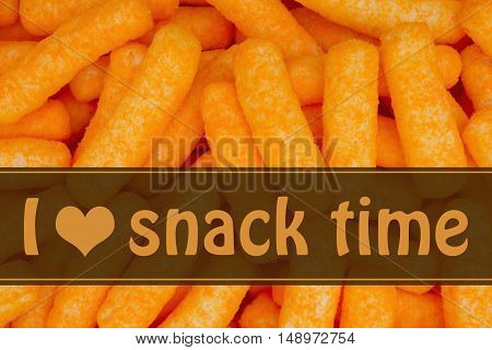 I love snack time message Orange cheese puff snack background with text I heart snack time
