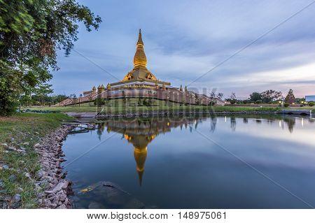 Maha Mongkol Bua Pagoda In Roi-ed Thailand At Sunset