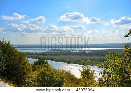 Panoramic view from the hill on the the Volga river near Samara city at sunny day. Beautiful natural landscape. Russia.