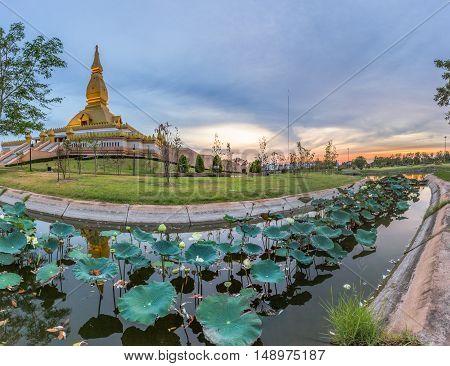 Famous Maha Mongkol Bua Pagoda In Roi-ed Thailand At Sunset.