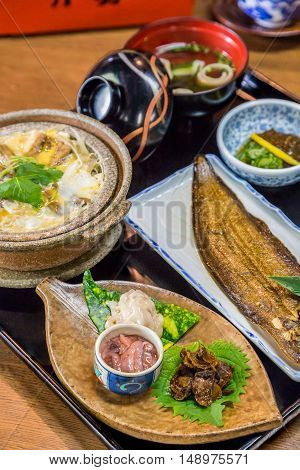 Luxurious Japanese Meal Set - Broiled Sole Fish And Boiled Loaches With Egg And Burdock.