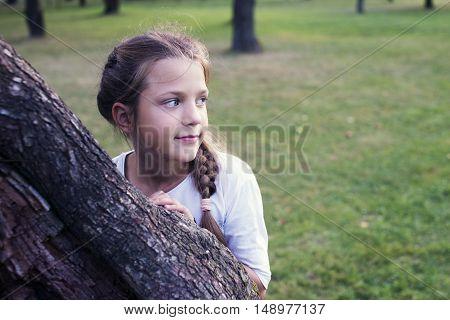 Girl Behind Tree