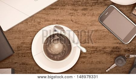 Overhead view of a notebook computer and a white cup of coffee on a rustic wooden cafe table. 3D illustration