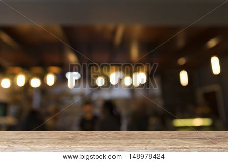 wood table with beverage counter at coffee shop restaurant (blur background)