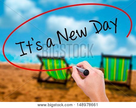 Man Hand Writing It's A New Day With Black Marker On Visual Screen
