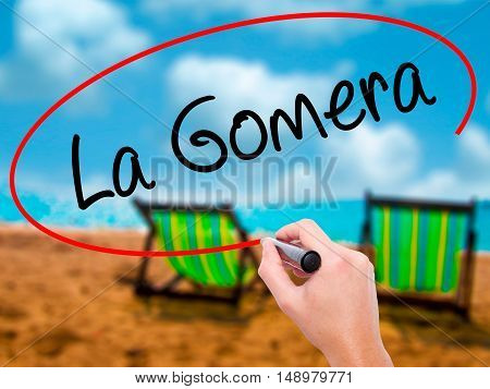 Man Hand Writing La Gomera With Black Marker On Visual Screen.