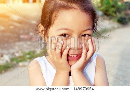 Portrait of a sweet happy preschool girl