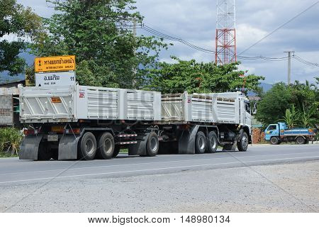 CHIANG MAI, THAILAND - JUNE 11 2015:  Trailer dump truck of D stone company. On road no.1001, 8 km from Chiangmai Business Area.