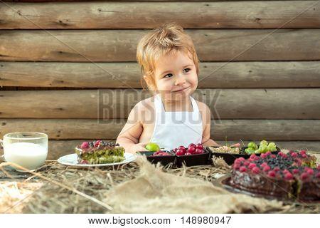 Little Boy Eats Green Apple