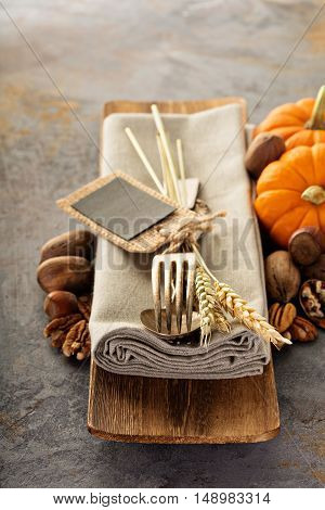 Cooking and eating in fall season, forks and spoon in a rustic autumn table setting