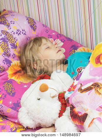Beautiful Little Girl With A Toy Polar Bear.